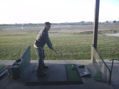 Tom Wharton     The Salt Lake Tribune Al Azad of Murray didn't let below freezing temperatures keep him from practicing his golf swing at Golf in the Round, which offers year-round driving range.