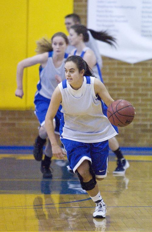 Paul Fraughton  |   Salt Lake Tribune Cyprus High School's  Julie Caputo starts the fast break at a recent practice.  Monday, January 28, 2013