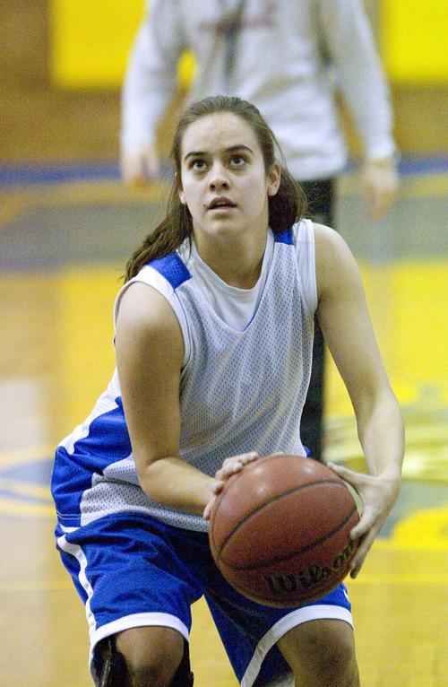 Paul Fraughton  |  Salt Lake Tribune Cyprus High School's Julie Caputo practices her free throws at a recent practice.