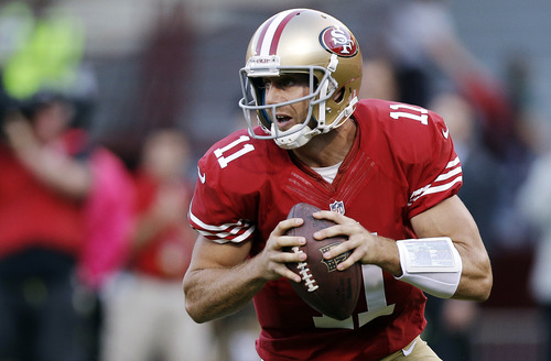 San Francisco 49ers quarterback Alex Smith (11) rolls out against the Seattle Seahawks during the first quarter of an NFL football game in San Francisco, Thursday, Oct. 18, 2012. (AP Photo/Marcio Jose Sanchez)