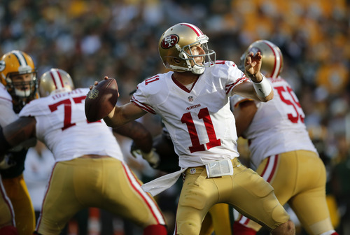 San Francisco 49ers' Alex Smith (11) drops back to pass during the second half of an NFL football game against the Green Bay Packers Sunday, Sept. 9, 2012, in Green Bay, Wis. The 49ers won 30-22. (AP Photo/Tom Lynn)