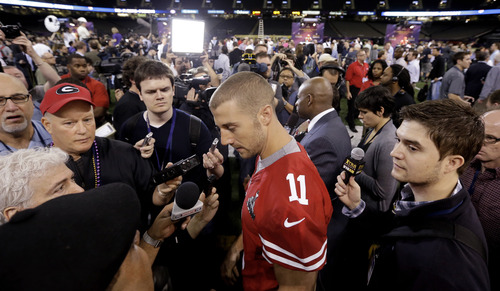 San Francisco 49ers quarterback Alex Smith (11) answers questions during media day for the NFL Super Bowl XLVII football game Tuesday, Jan. 29, 2013, in New Orleans. (AP Photo/Pat Semansky)