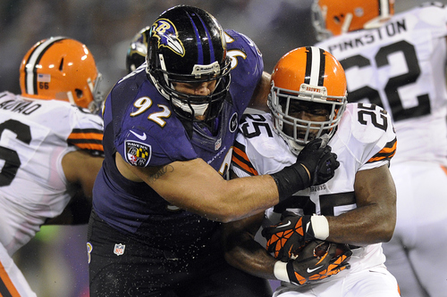 Baltimore Ravens defensive end Haloti Ngata stoops Cleveland Browns running back Chris Ogbonnaya during the first half of an NFL football game in Baltimore, Thursday, Sept. 27, 2012. (AP Photo/Nick Wass)