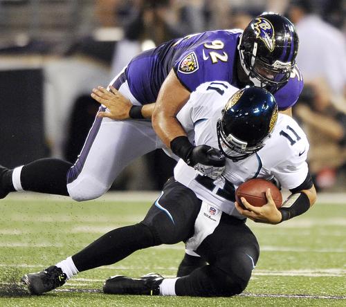 Jacksonville Jaguars quarterback Blaine Gabbert (11) is sacked by Baltimore Ravens defensive tackle Haloti Ngata in the first half of an NFL preseason football game in Baltimore, Thursday, Aug. 23, 2012. (AP Photo/Gail Burton)