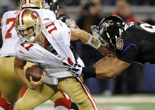 Baltimore Ravens defensive tackle Haloti Ngata, here pulling down San Francisco 49ers quarterback Alex Smith (11), has emerged as perhaps the NFL's top defensive tackle. Ngata graduated from Salt Lake City's Highland High. (AP Photo/Nick Wass)