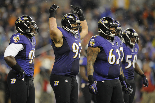Baltimore Ravens defensive end Haloti Ngata encourages his teammates during the first half of an NFL football game against the Cleveland Browns in Baltimore, Thursday, Sept. 27, 2012. (AP Photo/Nick Wass)