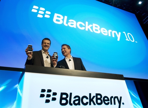 Andrew MacLeod, Blackberry Managing Director for Canada, left, and Brian Bidulka, Blackberry Chief Financial Officer, right, shake hands during the global launch of the new Blackberry BB10 in Toronto on Wednesday, January 30, 2013. (AP Photo/The Canadian Press, Nathan Denette)