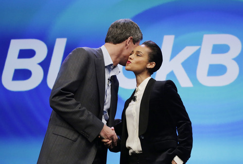(AP Photo/Mark Lennihan) CEO Thorsten Heins greets Grammy-winning artist Alicia Keys, who will be the company's global creative director, in charge of  working with app developers and entrepreneurs to further develop the BlackBerry 10 platform.
