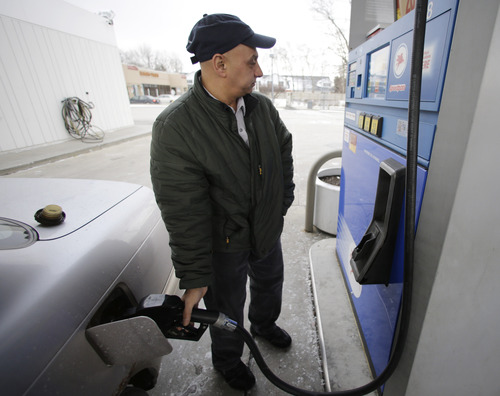 Samir Shabo fills up his tank at a Mobil gas station in Chicago, Thursday, Jan. 31, 2013. Gasoline prices are climbing as rising economic growth boosts oil prices and temporary refinery outages crimp gasoline supplies on the East and West Coasts. (AP Photo/Nam Y. Huh)