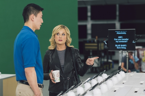 """This undated image provided by Best Buy, shows Amy Poehler on the set of the Company's Super Bowl commercial.  Best Buy's 30-second ad in the first quarter stars Amy Poehler, star of NBC's """"Parks and Rec,"""" asking a Best Buy employee """"lots of questions."""" (AP Photo/Best Buy)"""