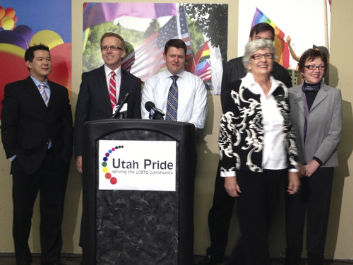Utah Pride Center board members hold a press conference Wednesday announcing plans to file court briefs with the U.S. Supreme Court, which will rule on two cases involving gay marriage. From L to R, Steven Ha, Allen Miller, Jon Jepsen, Nikki Boyer, and Billie Gay Larson. (Man in background is Kent Frogley) Courtesy image.