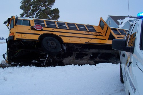 A school bus in Trenton, Utah slid off the road Wednesday afternoon while taking three children home from school, including one boy in a wheelchair. The Cache County Sheriff's Office reported no injuries in the crash. Authorities said deep drifts covering a ditch on the side of the road made it hard for the driver to see the edge of the road he was traveling on. Courtesy photo