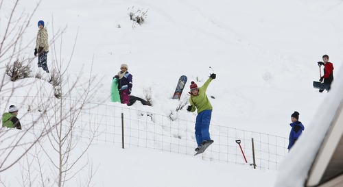 Leah Hogsten     The Salt Lake Tribune Kids snowboard off a ramp they constructed behind their homes in a Centerville neighborhood, Thursday, January 31, 2013.