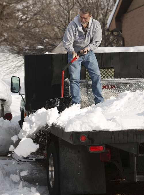 Leah Hogsten     The Salt Lake Tribune Rand Ridges of Centerville shovels snow off his flat-bed truck, Thursday, January 31, 2013 in his driveway.