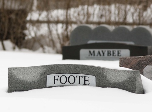 Leah Hogsten  |  The Salt Lake Tribune Headstones in the Farmington City Cemetery, Thursday, January 31, 2013 tell a different story about how much snow fell in Davis County in the past weeks.