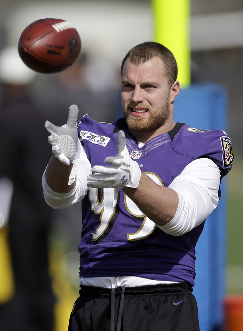 Baltimore Ravens linebacker Paul Kruger prepares to catch a pass during an NFL Super Bowl XLVII practice on Friday, Feb. 1, 2013, in Metairie, La. The Ravens face the San Francisco 49ers in Super Bowl XLVII on Sunday, Feb. 3. (AP Photo/Patrick Semansky)