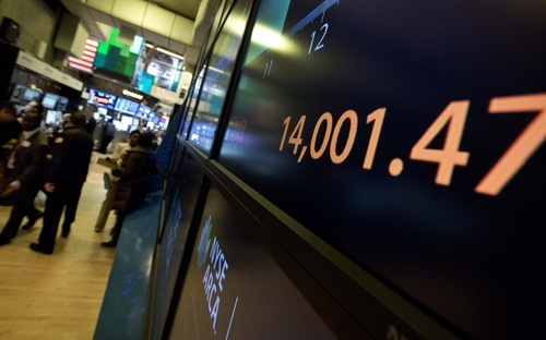 A screen on the trading floor of the New York Stock Exchange, on Friday, Feb. 1, 2013, shows the Dow Jones industrial average above 14,000 for the first time since October 2007. Evidence that the U.S. economic recovery is firmly on track drove markets higher on Friday, adding to the cheer from good economic indicators out of Europe. (AP Photo/Richard Drew)