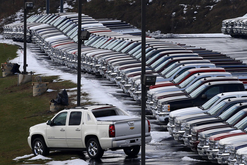 In this Wednesday, Jan. 9, 2013 photo, Chevy trucks line the lot of a dealer in Murrysville, Pa. Ford, Chrysler and General Motors all reported double-digit gains for January as last year's momentum in U.S. auto sales continued into 2013, according to reports Friday, Feb. 1, 2013. (AP Photo/Gene J. Puskar)