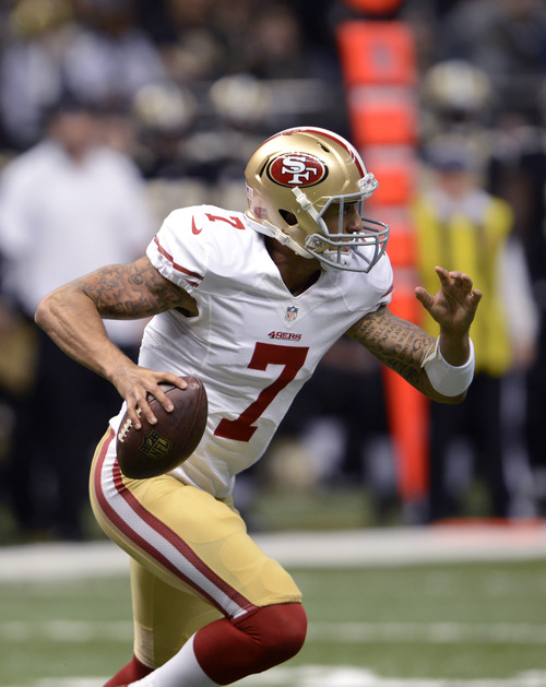 San Francisco 49ers quarterback Colin Kaepernick (7) in the first half of an NFL football game against the New Orleans Saints at the Louisiana Superdome in New Orleans, Sunday, Nov. 25, 2012. (AP Photo/Bill Feig)