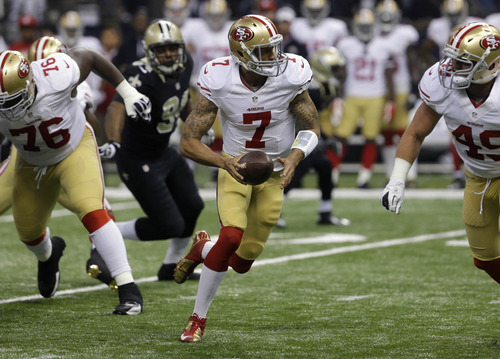 San Francisco 49ers quarterback Colin Kaepernick (7) looks to hand off in the first half of an NFL football game against the New Orleans Saints at the Louisiana Superdome in New Orleans, Sunday, Nov. 25, 2012. (AP Photo/Bill Haber)