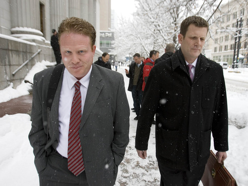Paul Fraughton  |  The Salt Lake Tribune Jeremy Johnson, left, leaves the federal courthouse with his lawyer, Nathan Crane, in Salt Lake City, Friday, Jan. 11, 2013. Crane has filed a motion to withdraw from his client's case.