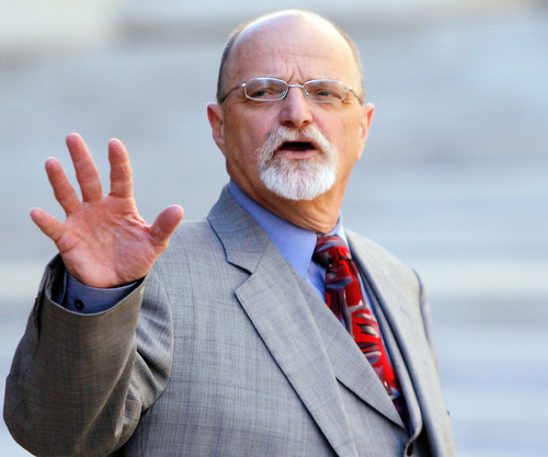 Defense attorney Ron Yengich, who now represents indicted St. George businessman Jeremy Johnson, waves as he arrives at the federal courthouse in Denver for oral arguments before the 10th Circuit U.S. Court of Appeals in the appeal of the conviction of environmental activist Tim DeChristopher, Thursday, May 10, 2012. (AP Photo/Ed Andrieski)