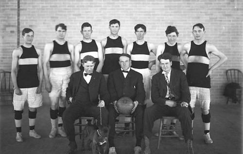 (Courtesy of Utah Historical Society)  The University of Utah basketball team posing for team photo with their coaches and mascot in 1909.