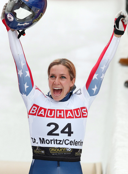 Second placed US athlete Noelle Pikus-Pace celebrates in the finish aera after the skeleton World Championships in St. Moritz, Switzerland, Friday, Feb. 1, 2013. (AP Photo/Keystone, Arno Balzarini)