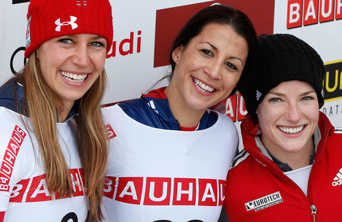 British winner Shelley Rudman, center, celebrates on the podium with second placed US athlete Noelle Pikus-Pace, left, and third placed Canadian Sarah Reid after the women's skeleton World Championships in St. Moritz, Switzerland, Friday, Feb. 1, 2013. (AP Photo/Keystone, Arno Balzarini)