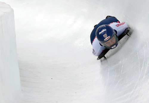 US athlete Noelle Picus-Pace speeds down the course during the third run of the women's skeleton World Championship in St. Moritz, Switzerland, Friday, Feb. 1, 2013. (AP Photo/Keystone, Arno Balzarini)