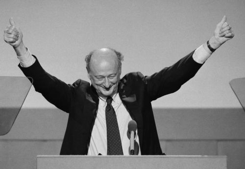 """FILE - In this July 16, 1984, file photo, New York Mayor Ed Koch raises his hands with two thumbs up while addressing the opening session of the Democratic National Convention in San Francisco. Ed Koch, right, as they leave New York's Grand Central after holding a news conference for the """"Committee to Save Grand Central Station."""" Koch, the combative politician who rescued the city from near-financial ruin during three City Hall terms, has died at age 88. Spokesman George Arzt says Koch died Friday morning Feb. 1, 2013 of congestive heart failure. (AP Photo/Ira Schwarz, File)"""
