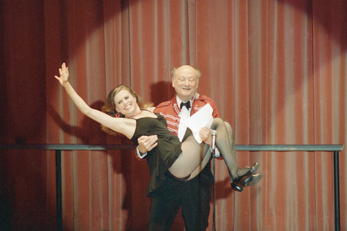 FILE - In this March 8, 1987, file photo, New York Mayor Ed Koch gives a lift to Broadway dancer Ann Reinking during a performance of political satire on at the annual Inner Circle gathering of the New York Press Club in New York. Koch, the combative politician who rescued the city from near-financial ruin during three City Hall terms, has died at age 88. Spokesman George Arzt says Koch died Friday morning Feb. 1, 2013 of congestive heart failure. (AP Photo/Frank Franklin II, File)  (AP Photo/Richard Drew, File)