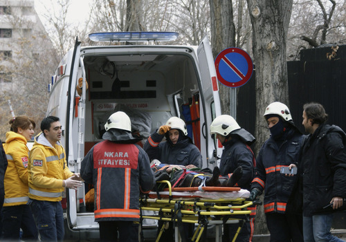 Medics and firefighters carry an injured woman on a stretcher to an ambulance after a suicide bomber detonated an explosive device at the entrance of the U.S. Embassy in the Turkish capital, Ankara, Turkey, Friday, Feb. 1, 2013.  A suspected suicide bomber detonated an explosive device at the entrance of the U.S. Embassy in the Turkish capital on Friday, killing himself and one other person, officials said.  (AP Photo/IHA)