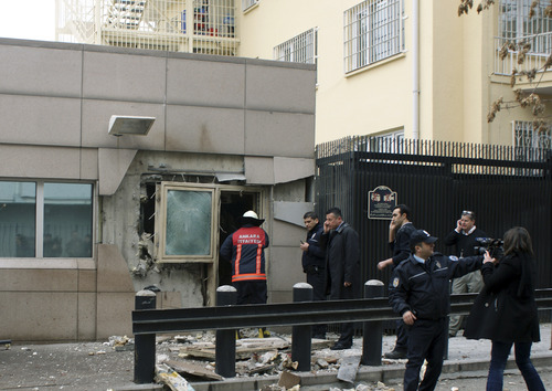 Gate 2 of the embassy just after a suicide bomber detonated an explosive device at the entrance of the U.S. Embassy in the Turkish capital, Ankara, Turkey, Friday, Feb. 1, 2013. A suspected suicide bomber detonated an explosive device at the entrance of the U.S. Embassy in the Turkish capital on Friday, killing himself and one other person, officials said.  (AP Photo/IHA)