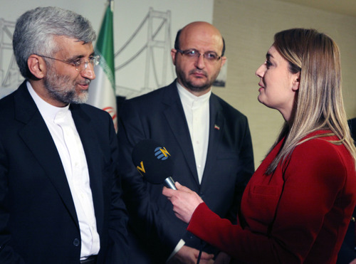 "FILE - In this April 14, 2012 file photo, Didem Tuncay, then a diplomatic reporter for Turkish news channel NTV, interviews Iran's Chief nuclear negotiator Saeed Jalili in Istanbul, Turkey. Tuncay, a respected television journalist, 38, was injured after a suicide bomber detonated an explosive device at the entrance of the U.S. Embassy in the Turkish capital, Ankara, Turkey, Friday, Feb. 1, 2013, A hospital official said she was "" not in a critical conditoion."" (AP Photo/Burhan Ozbilici, File)"