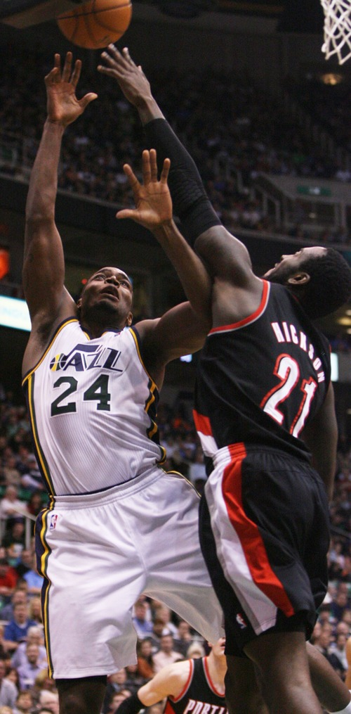 Kim Raff  |  The Salt Lake Tribune (left) Utah Jazz power forward Paul Millsap (24) shoots the ball past Portland Trail Blazers center J.J. Hickson (21) during the second half at EnergySolutions Arena in Salt Lake City on February 1, 2013. The Jazz went on to win the game 86-77.