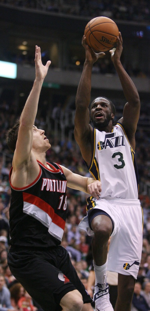 Kim Raff  |  The Salt Lake Tribune (left) Portland Trail Blazers small forward Victor Claver (18) defends as Utah Jazz small forward DeMarre Carroll (3) drives the basket during the second half at EnergySolutions Arena in Salt Lake City on February 1, 2013.  The Jazz went on to win the game 86-77.