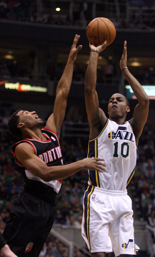 Kim Raff  |  The Salt Lake Tribune (right) Utah Jazz point guard Alec Burks (10) shoots the ball as (left) Portland Trail Blazers point guard Ronnie Price (24) defends during the second half at EnergySolutions Arena in Salt Lake City on February 1, 2013.  The Jazz went on to win the game 86-77.