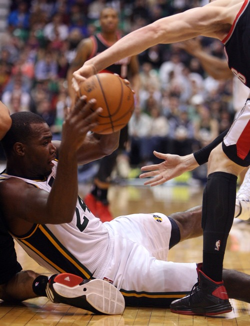 Kim Raff  |  The Salt Lake Tribune (left) Utah Jazz power forward Paul Millsap (24) tries to maintain control as Portland Trail Blazers small forward Luke Babbitt (8) tries to free the ball loose during the second quarter at EnergySolutions Arena in Salt Lake City on February 1, 2013.