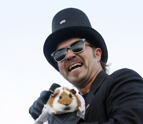 Rick Egan  |  The Salt Lake Tribune  Sunset Mayor Chad Bangerter holds Sam the guinea pig while officiating over the annual Sunset Sam event Saturday, February 2, 2013. Sam did not see the sunset as the sun was covered by clouds, predicting an early spring.