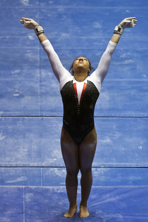 Chris Detrick  |  The Salt Lake Tribune Utah's Kassandra Lopez competes on the bars during the meet against Arizona State at the Huntsman Center Friday February 1, 2013. Utah won 196.425 to 195.450.