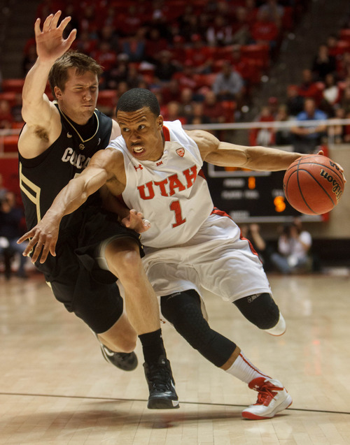 Trent Nelson  |  The Salt Lake Tribune Utah's Glen Dean drives on Colorado's Eli Stalzer as Utah hosts Colorado, college basketball Saturday, February 2, 2013 in Salt Lake City.