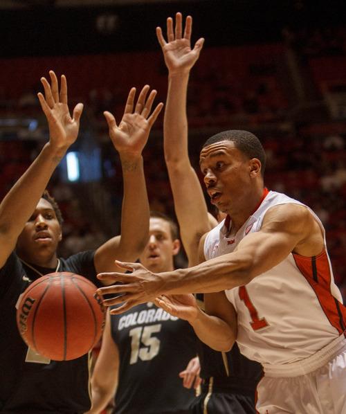 Trent Nelson  |  The Salt Lake Tribune Utah's Glen Dean passes the ball in traffic as Utah hosts Colorado, college basketball Saturday, February 2, 2013 in Salt Lake City.