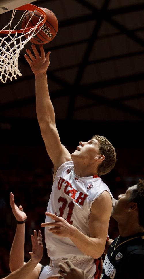 Trent Nelson  |  The Salt Lake Tribune Utah's Dallin Bachynski shoots the ball as Utah hosts Colorado, college basketball Saturday, February 2, 2013 in Salt Lake City.