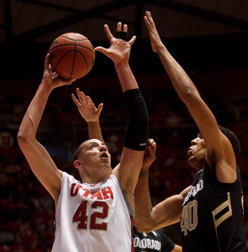 Trent Nelson  |  The Salt Lake Tribune Utah's Jason Washburn puts up a shot, with Colorado's Josh Scott defending as Utah hosts Colorado, college basketball Saturday, February 2, 2013 in Salt Lake City.