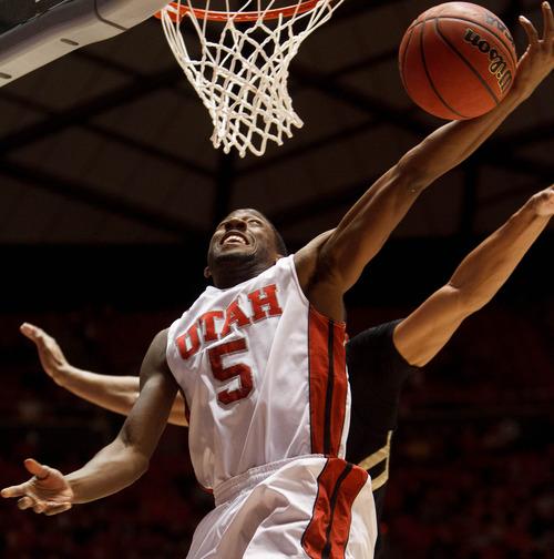 Trent Nelson  |  The Salt Lake Tribune Utah's Jarred DuBois drives to the basket as Utah hosts Colorado, college basketball Saturday, February 2, 2013 in Salt Lake City.