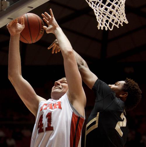 Trent Nelson     The Salt Lake Tribune Utah's Jeremy Olsen, defended by Colorado's Xavier Johnson as Utah hosts Colorado, college basketball Saturday, February 2, 2013 in Salt Lake City.