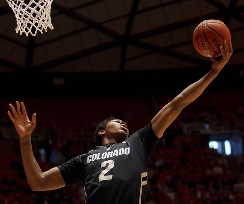 Trent Nelson  |  The Salt Lake Tribune Colorado's Xavier Johnson pulls in a rebound as Utah hosts Colorado, college basketball Saturday, February 2, 2013 in Salt Lake City.