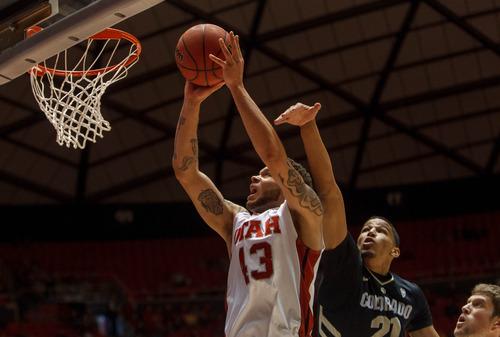 Trent Nelson  |  The Salt Lake Tribune Utah's Alex Mortensen shoots ahead of Colorad's Andre Roberson as Utah hosts Colorado, college basketball Saturday, February 2, 2013 in Salt Lake City.