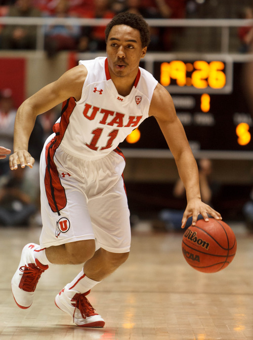 Trent Nelson  |  The Salt Lake Tribune Utah's Brandon Taylor dribbles the ball as Utah hosts Colorado, college basketball Saturday, February 2, 2013 in Salt Lake City.